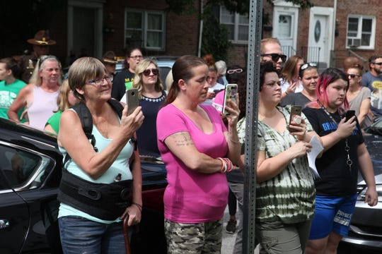 Overlook Colony residents watch New Castle County Executive Matt Meyer during a press conference in their neighborhood Tuesday morning.