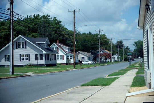 A man walks along the streets of Seaford, a place where DuPont's thousands of jobs once brought prosperity.