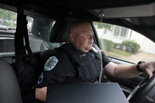 Cpl. Mark Burton with the Ocean View Police Department patrols some of the upscale neighborhoods that have seen several overdoses from heroin that is hitting the area.