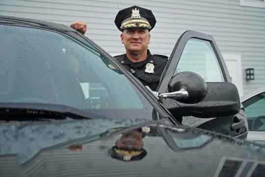 Ocean View Police Chief Kenneth McLaughlin stands with his patrol vehicle.