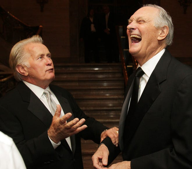 Martin Sheen (left) and Alan Alda joke at a reception for recipients of the Common Wealth Awards at the Hotel DuPont, Saturday, April 20, 2013.