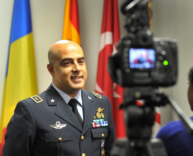 Lt. Col. Vincenzo Repici, incoming Sheppard Air Force Base Italian senior national representative for the Euro-NATO Joint Jet Pilot Training Program, answers media questions shortly before a change of command ceremony held at SAFB Tuesday.