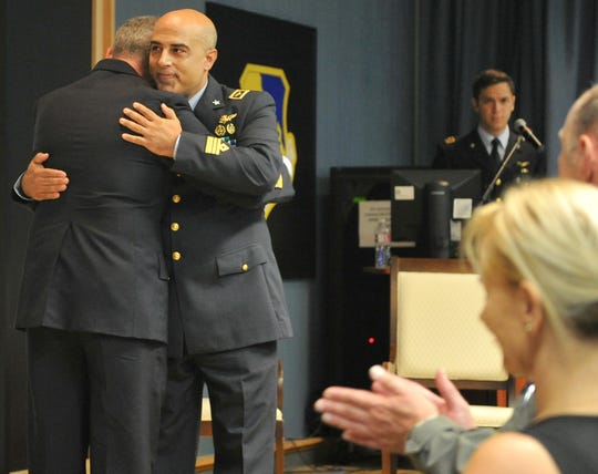 Lt. Col. Vincenzo Repici, right, receives a hug from Lt. Col. Pier Luigi Del Vecchio Tuesday morning during a change of command ceremony held at Sheppard AFB. Repici will be replacing Del Vecchio as the Italian senior representative for the Euro-NATO Joint Jet Pilot Training Program.