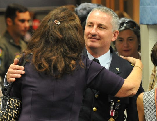 Lt. Col. Pier Luigi Del Vecchio, right, outgoing Sheppard Air Force Base Italian senior national representative for the Euro-NATO Joint Jet Pilot Training Program, receives hugs and well-wishes Tuesday morning after a change of command ceremony.
