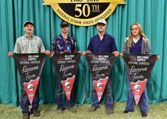 Wisconsin junior members won second place finish in the fitting contest at the 2018 National Junior Angus Show (NJAS) Awards Ceremony, July 12 in Madison, Wis. Pictured from left are Samuel Henderson, East Troy; Kole Lorentz, Woodville; John Henderson, East Troy; and Kelly Gaffney, Barneveld.