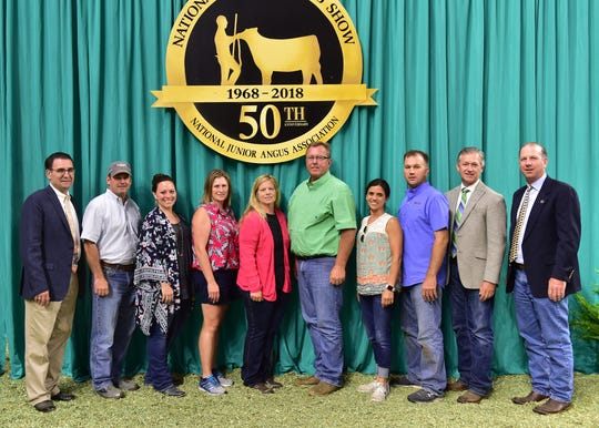 The Illinois and Wisconsin Angus Associations made a significant contribution of $50,000 (minimum) to the Angus Foundation's National Junior Angus Show Endowment Fund at the 2018 National Junior Angus Show (NJAS) Awards Ceremony, July 12 in Madison, Wis. Pictured from left are Milford Jenkins, Angus Foundation president; Jeff Dameron; Alicia Miller; Val Gaffney; Diane Handsaker; Jim Hawthorne; Theresa and Alan Miller; Rod Schoenbine, Angus Foundation director of development; and James Coffey, Angus Foundation chairperson. These funds will be permanently endowed, and the annual investment earnings, per the Angus Foundation's Spending Policy, will be provided to state Angus associations in the future when hosting the NJAS.
