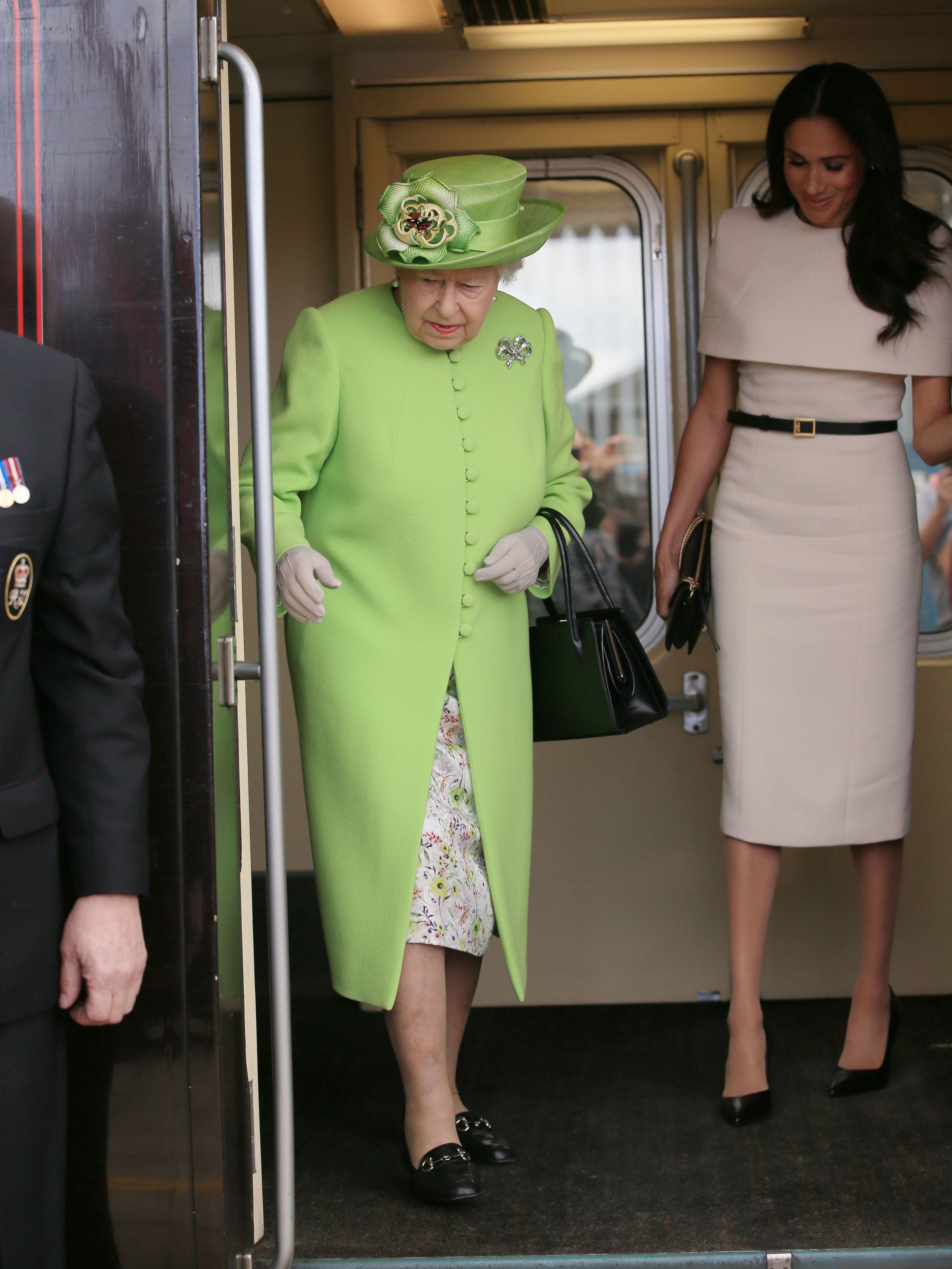 Queen Elizabeth II and Duchess Meghan arrive in Cheshire by Royal Train on June 14, 2018. It was Meghan's first solo engagement with Her Majesty, just a month after her wedding to Prince Harry.