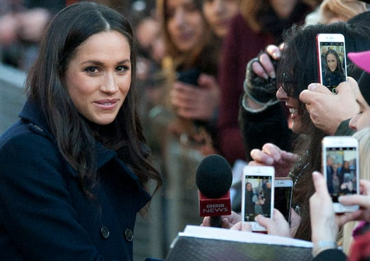 Meghan Markle in her first official public engagement with Prince Harry, just days after announcing their engagement, greeting well-wishers in a walkabout in Nottingham, England, on Dec. 1, 2017.