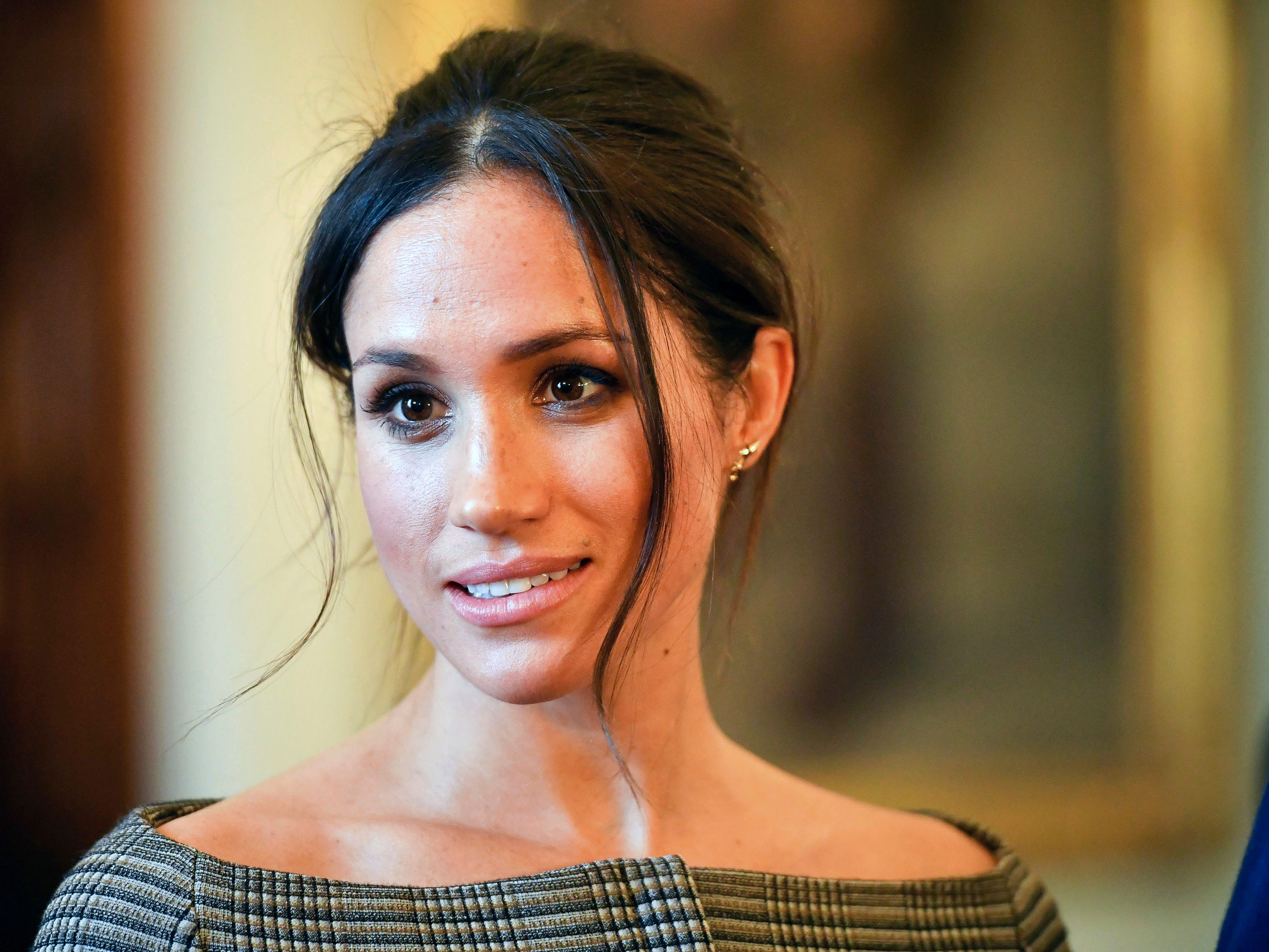 Meghan Markle wore a messy bun while visiting Cardiff Castle in Wales on Jan. 18, 2018.