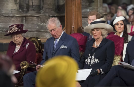 Queen Elizabeth II (from left), Prince Charles, Duchess Camilla, Prince Harry and Meghan Markle attend the Commonwealth Day service at Westminster Abbey on March 12, 2018.