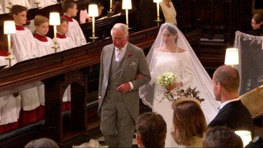 Meghan Markle walks down the aisle with Prince Charles for her wedding at St. George's Chapel in Windsor Castle on May 19, 2018.
