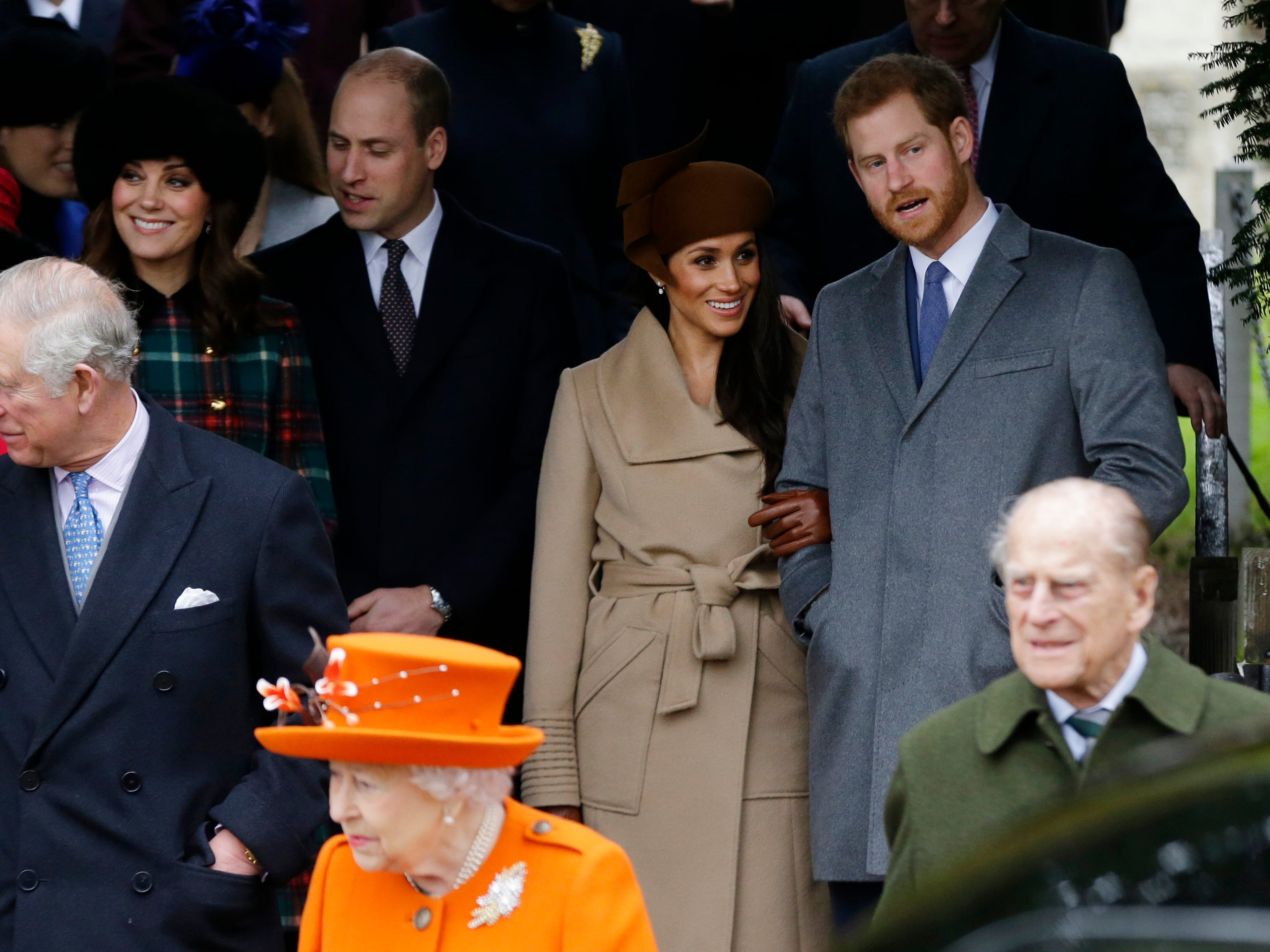 Meghan Markle (in tan coat) gathers with the royal family for Christmas Day service in Sandringham, a first for a royal bride-to-be, in 2017.