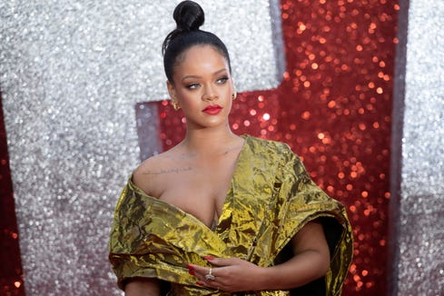 e08de8eb8aa Rihanna s British  Vogue  cover is simply stunning
