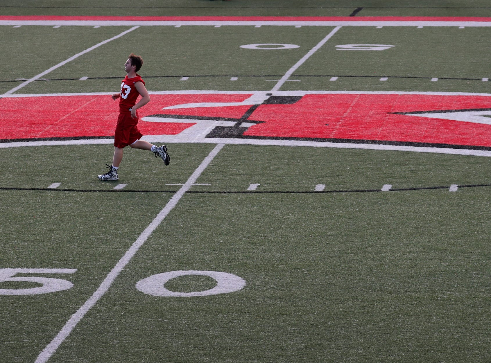 Caleb Briski warms up during the Kimberly High School football practice Wednesday, August 1, 2018, at Papermaker Stadium in Kimberly, Wis. 