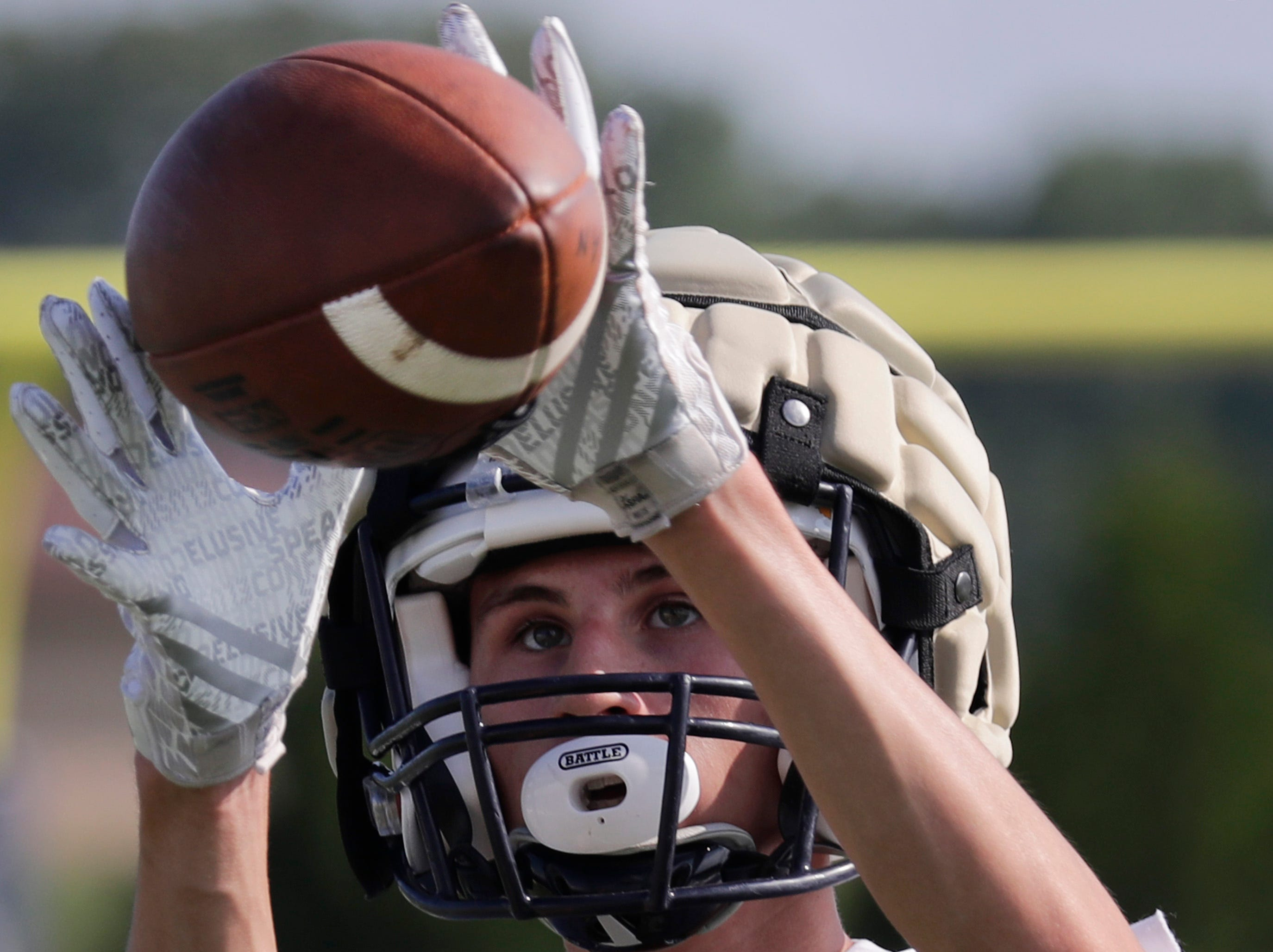 Appleton North Lightning's Drew Peters catches a pass during practice on Wednesday August 1, 2018 at Appleton North High School in Appleton Wis.