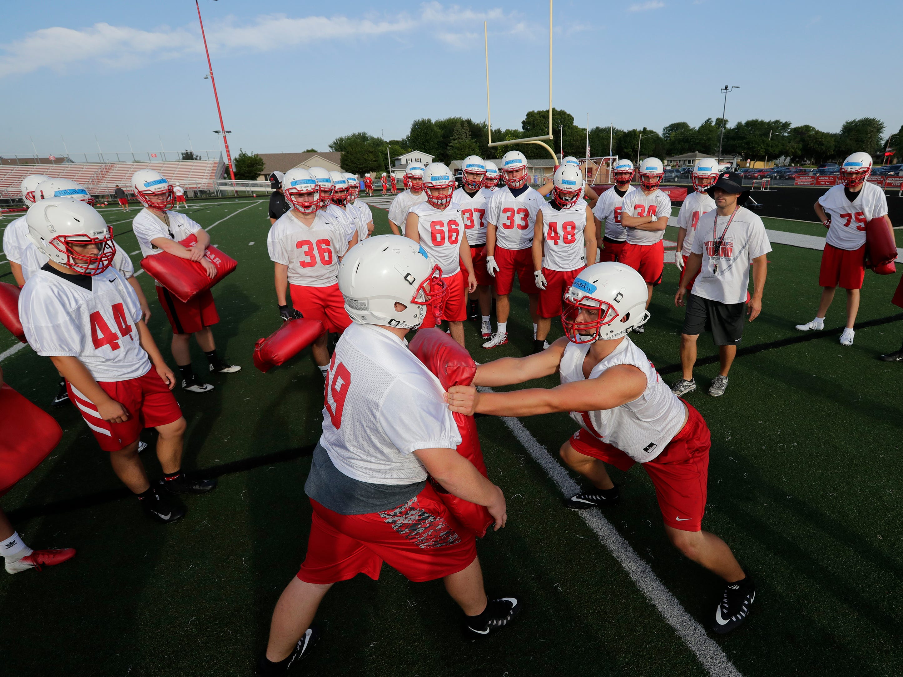 The defense works on a drill during the Kimberly High School football practice Wednesday, August 1, 2018, at Papermaker Stadium in Kimberly, Wis. 