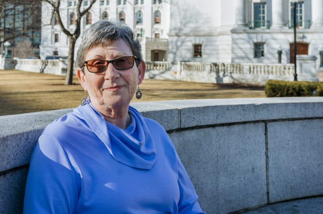 Sheila Plotkin is the founder of We, the Irrelevant, a grassroots group dedicated to documenting the decreasing power of citizens on state government. She is photographed in front of the Wisconsin State Capitol on February 27, 2018.