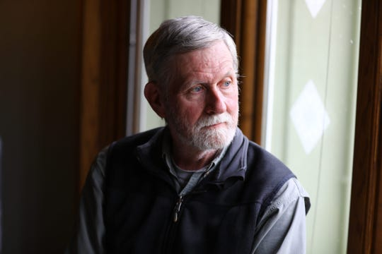 "Robert Rolley, a retired Wisconsin Department of Natural Resources wildlife research biologist, says he has seen regular citizens lose influence over natural resource decisions. He is seen here at his home in Baraboo, Wis., on May 21, 2018. ""There is a long history in the DNR of listening to public input prior to making management decisions,"" says Rolley, who worked at the agency for 25 years. ""What has changed is which citizens the DNR Board and administration is interested in listening to."""