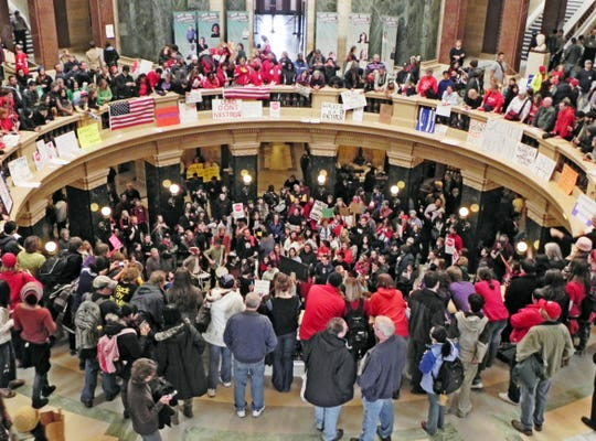 Union workers, teachers and other protesters showed up for weeks at Wisconsin's Capitol building in protest of Gov. Scott Walker's budget repair bill, later known as Act 10, which reduced public sector union workers' benefits and eliminated collective bargaining rights for many of them.