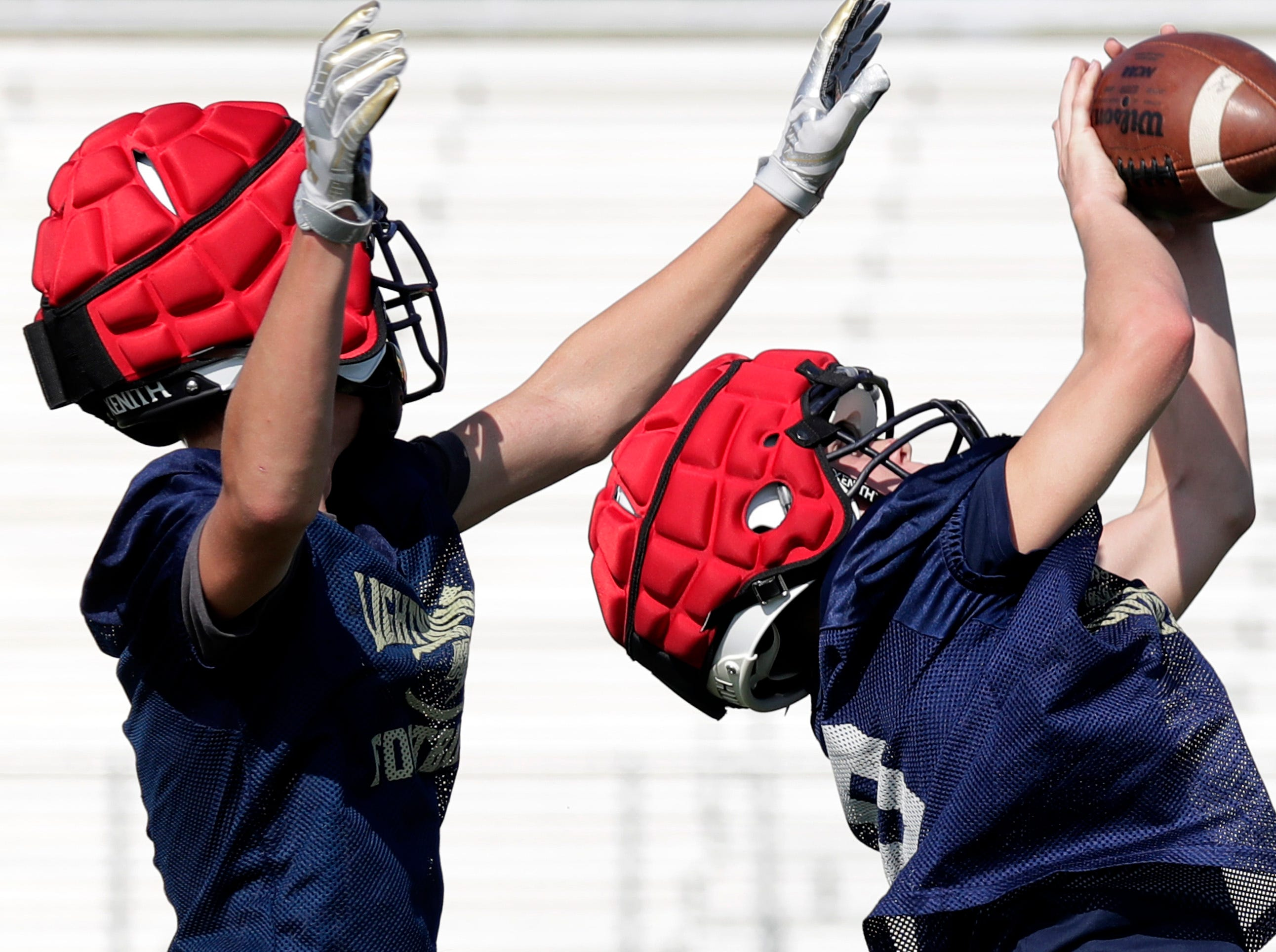 Appleton North Lightning's Bode Verstegen, left, and Sebastian Hayes run defensive drills during practice on Wednesday August 1, 2018 at Appleton North High School in Appleton Wis.