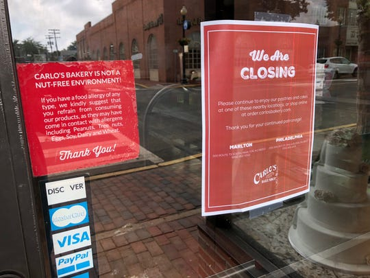 A sign went up on the door announcing that Carlo's Bakery has closed.
