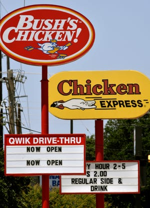 The newly-opened Bush's Chicken restaurant is next door to a Chicken Express on E.N. 10th Street, Wednesday. The site used to be an Arby's.