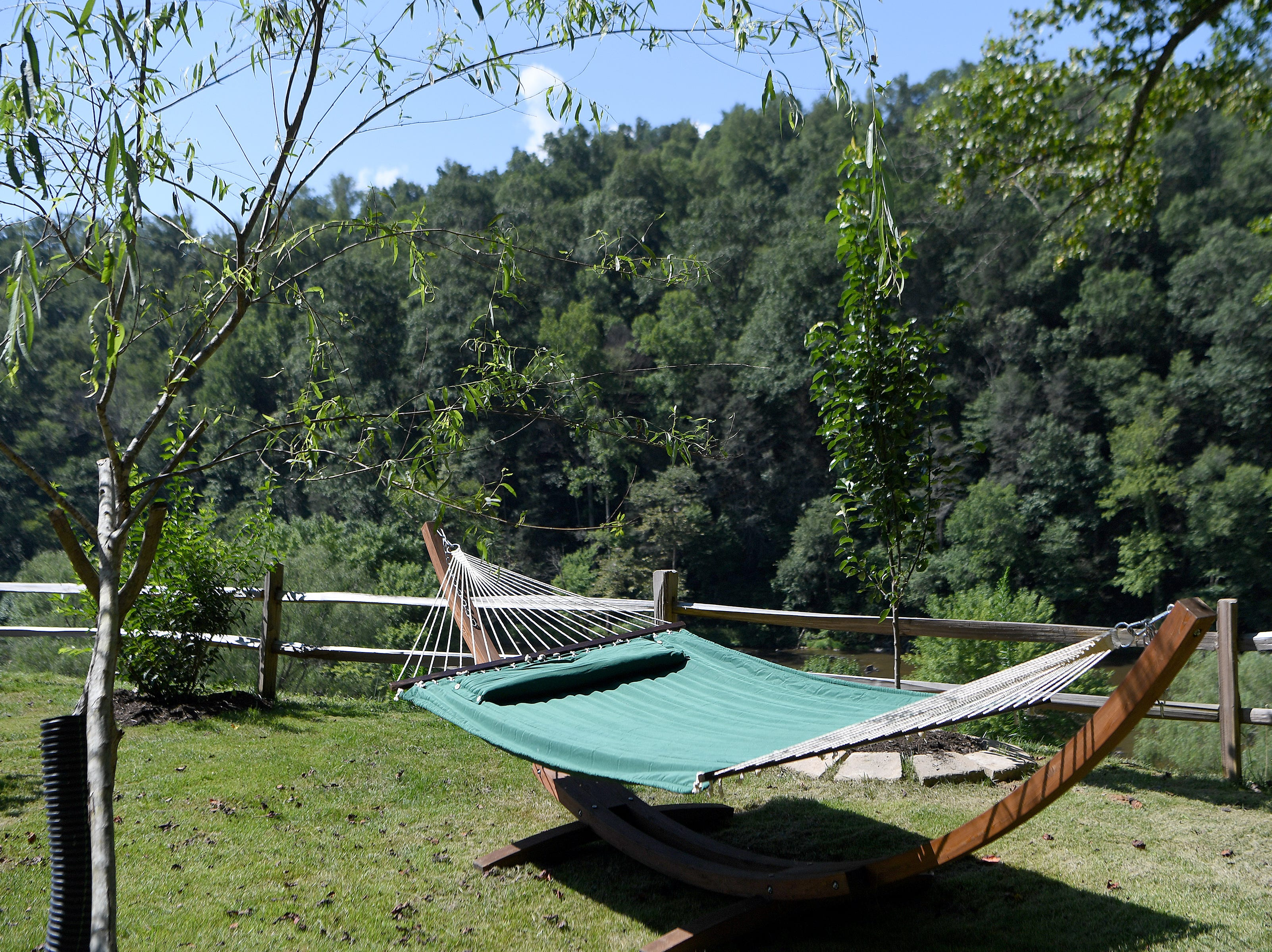 A relaxing hammock view outside of the Yin Yurt, an AirBnB rental on Ricardo Fernandez's property in Clyde.