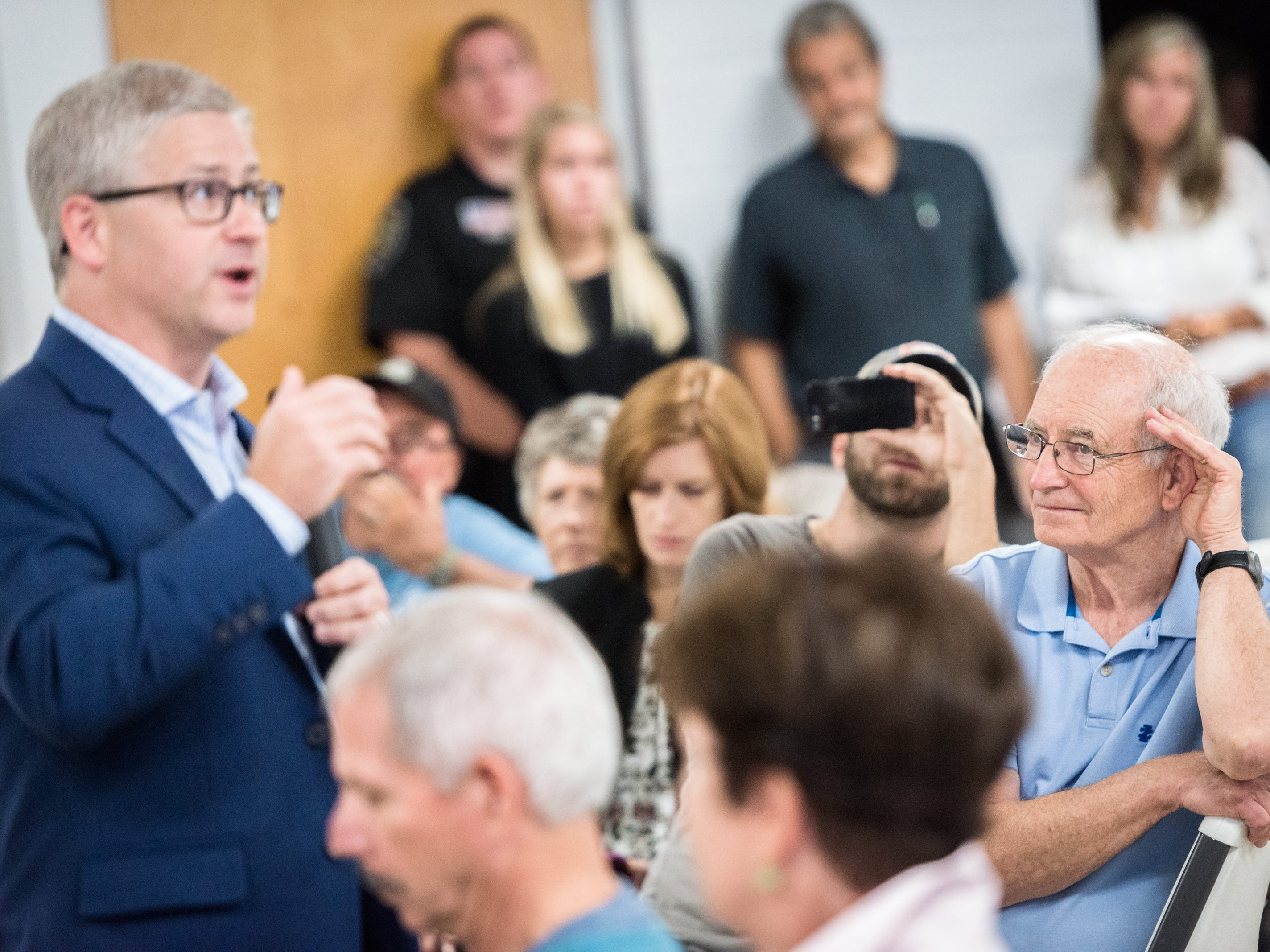 An attendee of the town hall meeting with Patrick McHenry, the U.S representative for North Carolina's 10th congressional district, listens to his response to a question taken at the Riceville Volunteer Fire Department Wednesday, August 1, 2018.