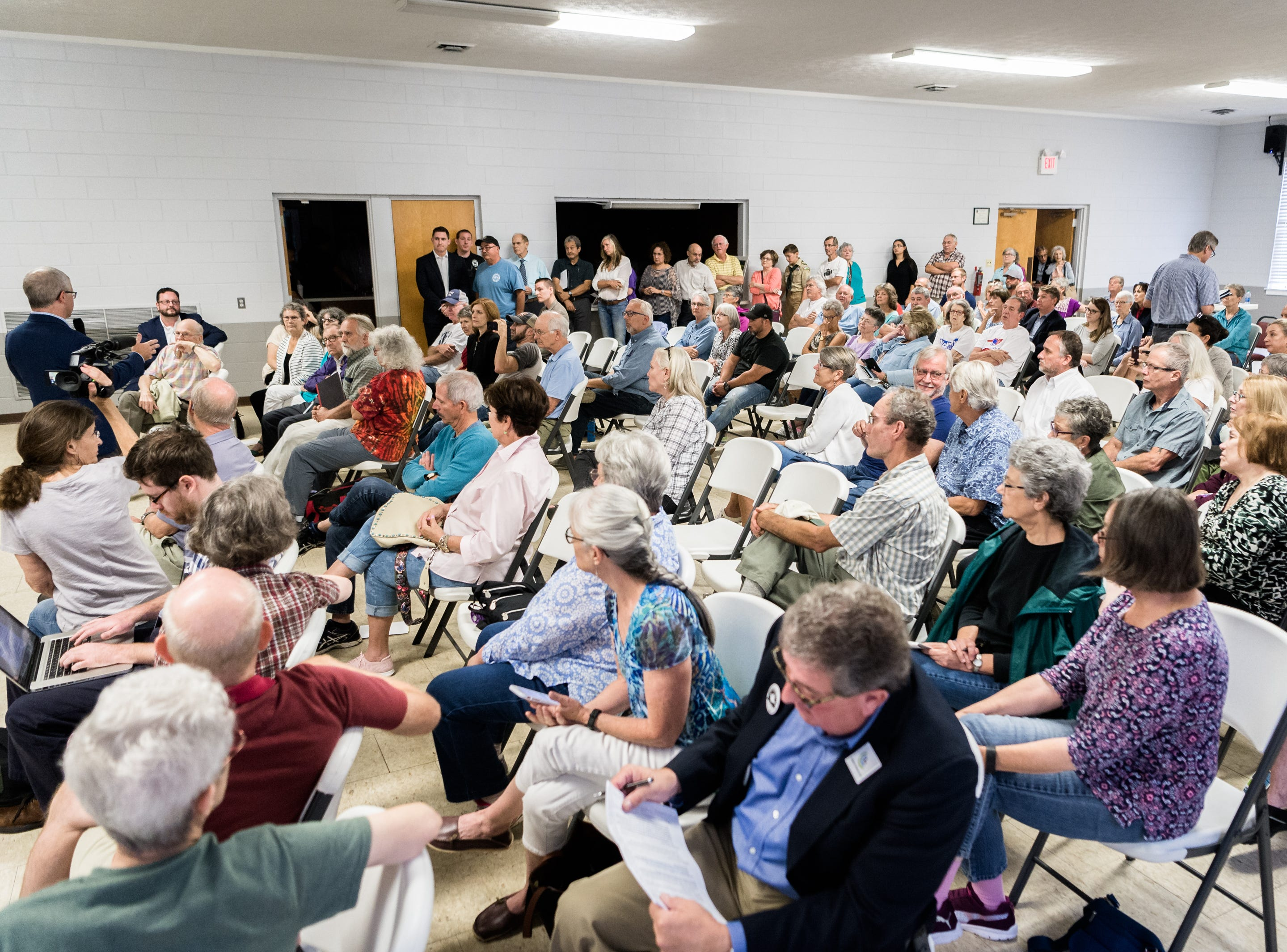 Attendees of a town hall meeting with Patrick McHenry, the U.S representative for North Carolina's 10th congressional district fill the room at the Riceville Volunteer Fire Department Wednesday, August 1, 2018.
