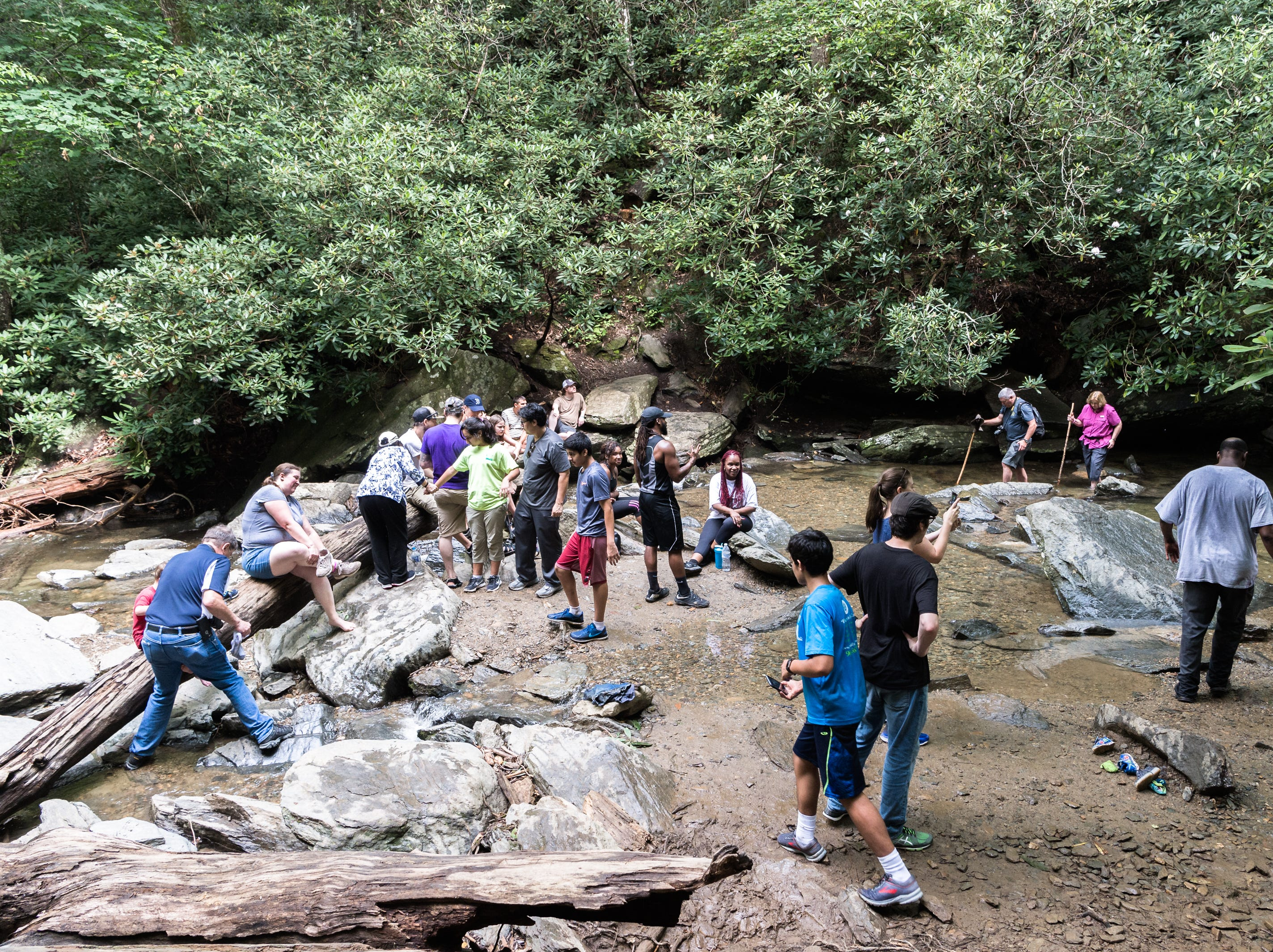 Visitors to Catabwa Falls in the Pisgah National Forest in Old Fort wade in the pool at the base of the falls Friday, July 13, 2018.