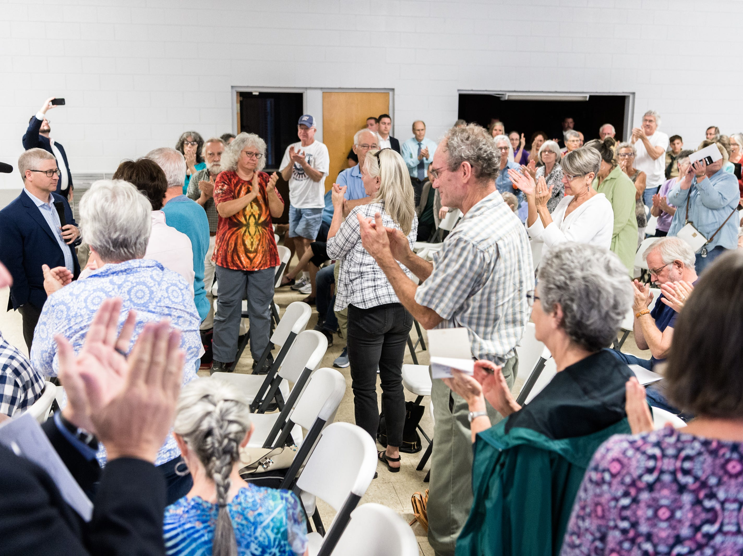 Attendees of a town hall meeting with Patrick McHenry, the U.S representative for North Carolina's 10th congressional district at the Riceville Volunteer Fire Department applaud an audience member's questions during the meeting at the Riceville Volunteer Fire Department Wednesday, August 1, 2018.