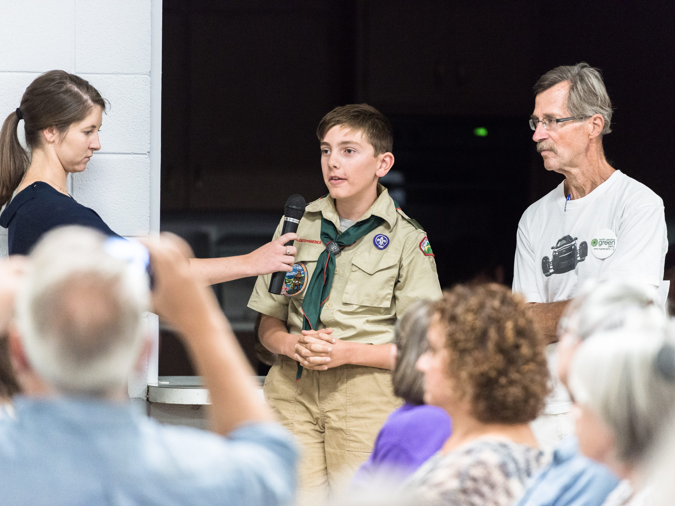 A young attendee of a town hall meeting with Patrick McHenry, the U.S representative for North Carolina's 10th congressional district, asks him a question at the Riceville Volunteer Fire Department Wednesday, August 1, 2018.