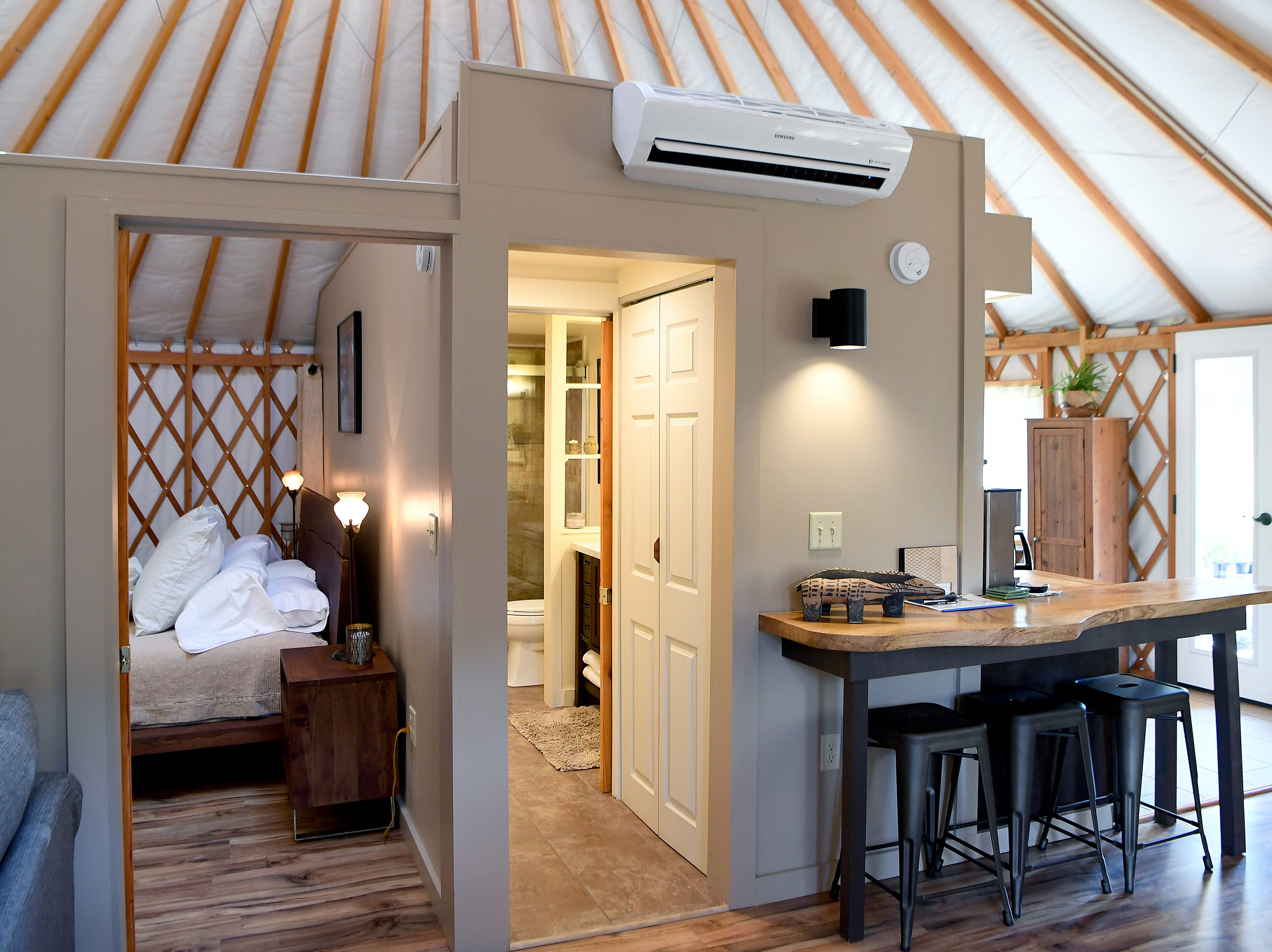 The Yin Yurt, an AirBnB rental on Ricardo Fernandez's property in Clyde, features all of the amenities of a small home including air conditioning, heating and a humidifier to make staying a comfortable experience. The bedroom and bathroom are partitioned from the rest of the living space.