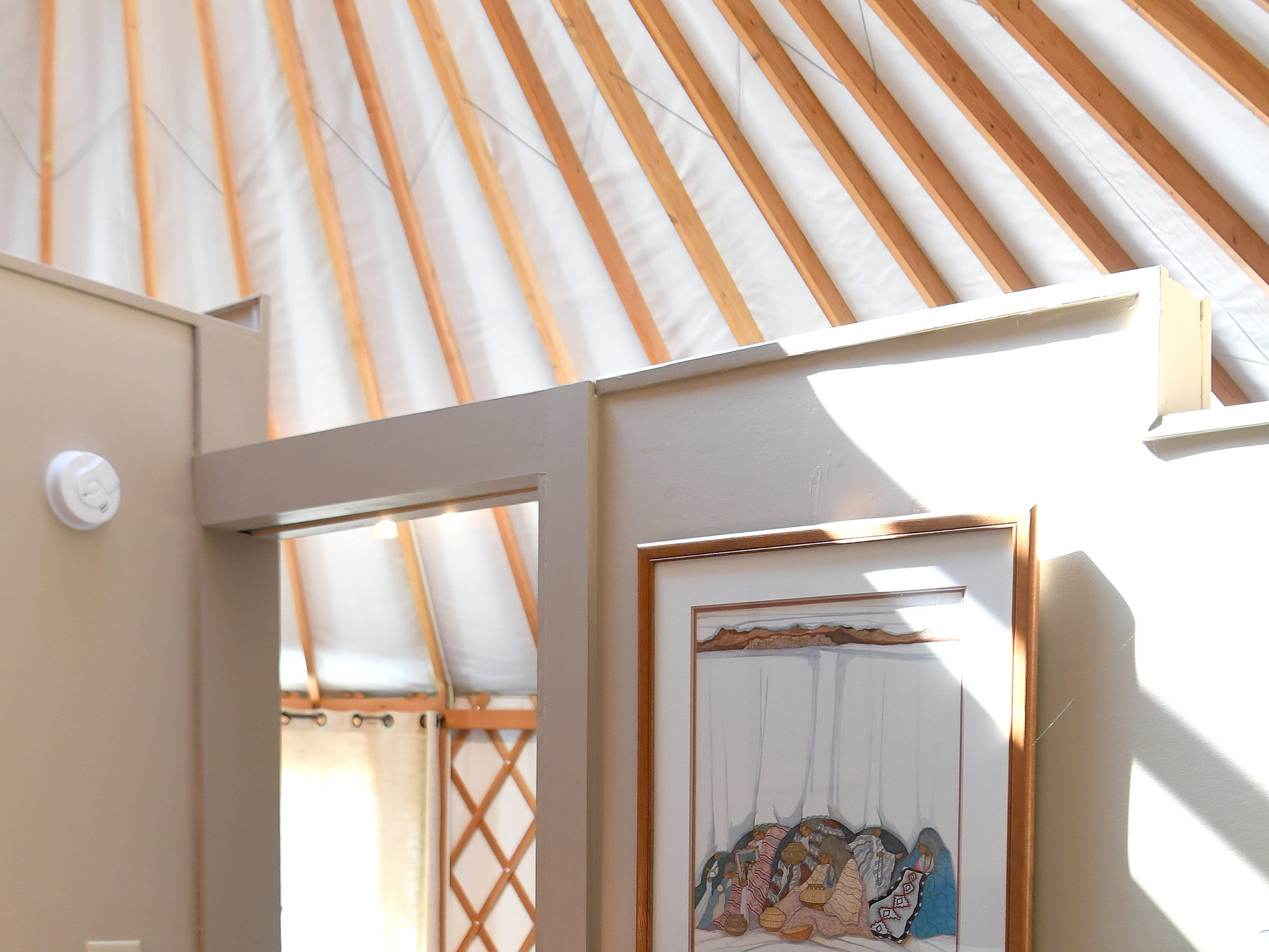 The bedroom of the Yin Yurt, an AirBnB rental on Ricardo Fernandez's property in Clyde.