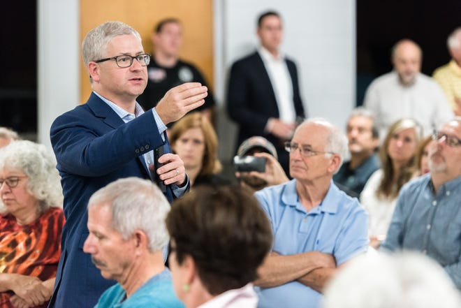 Patrick McHenry, the U.S representative for North Carolina's 10th congressional district, responds to questions during the town hall meeting at the Riceville Volunteer Fire Department Wednesday, August 1, 2018.