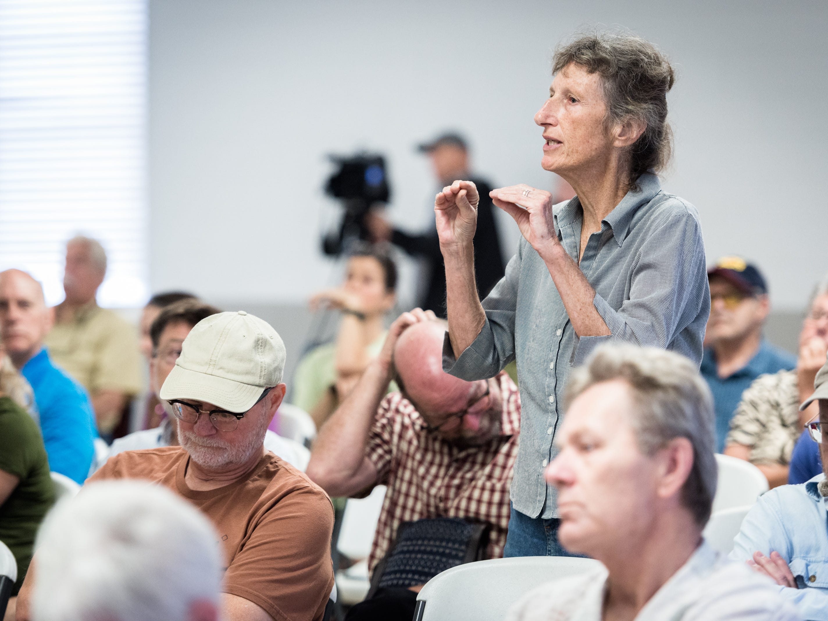 Cathy Scott, of Asheville, questions Patrick McHenry, the U.S representative for North Carolina's 10th congressional district, on why he has not condemned the behavior of president Donald Trump during a town hall meeting at the Riceville Volunteer Fire Department Wednesday, August 1, 2018.