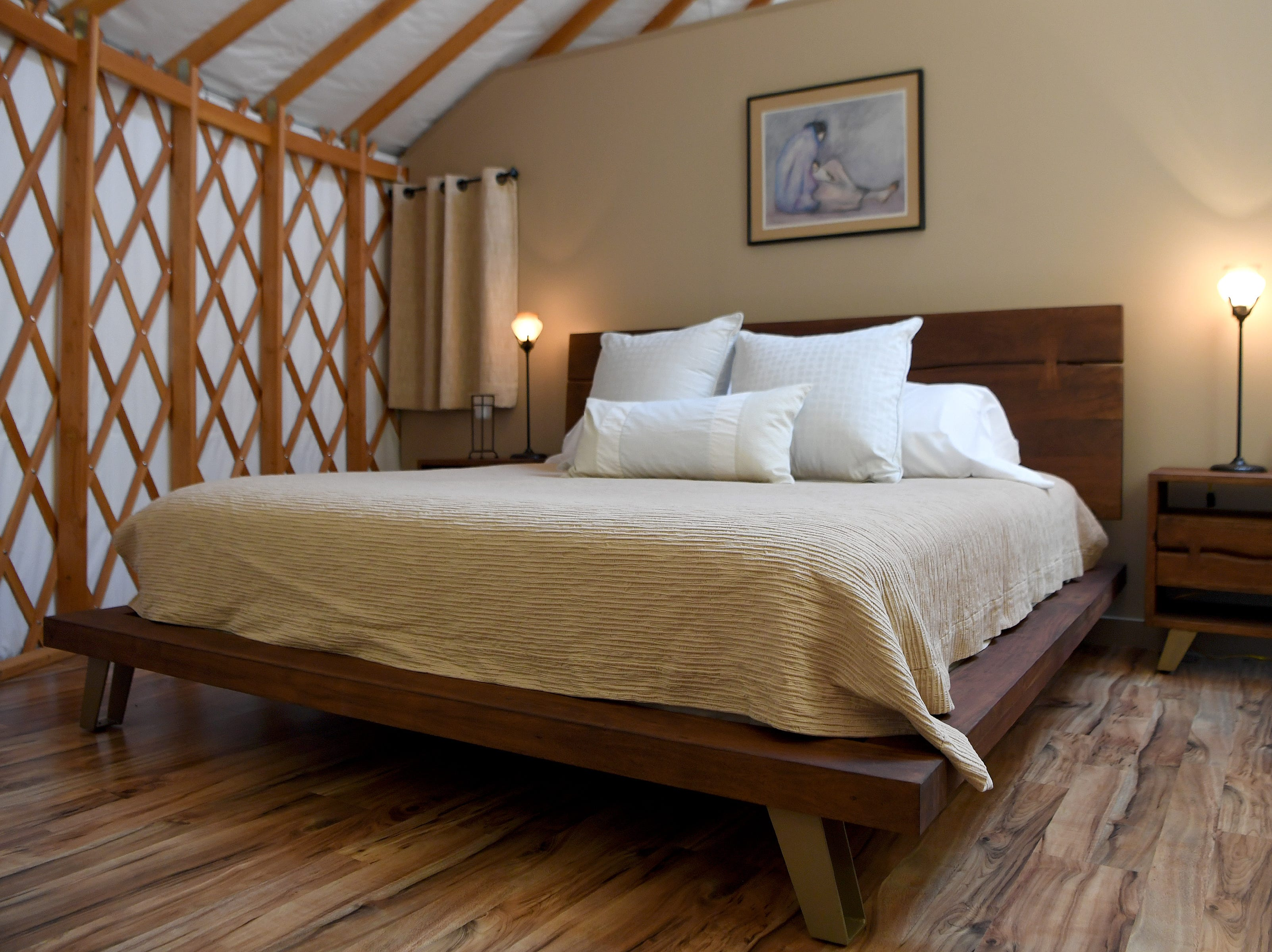 The Yin Yurt, an AirBnB rental on Ricardo Fernandez's property in Clyde, features a king-sized bed for guests in the partitioned bedroom. The yurt sleeps four with the addition of a pull-out sofa in the living room area.