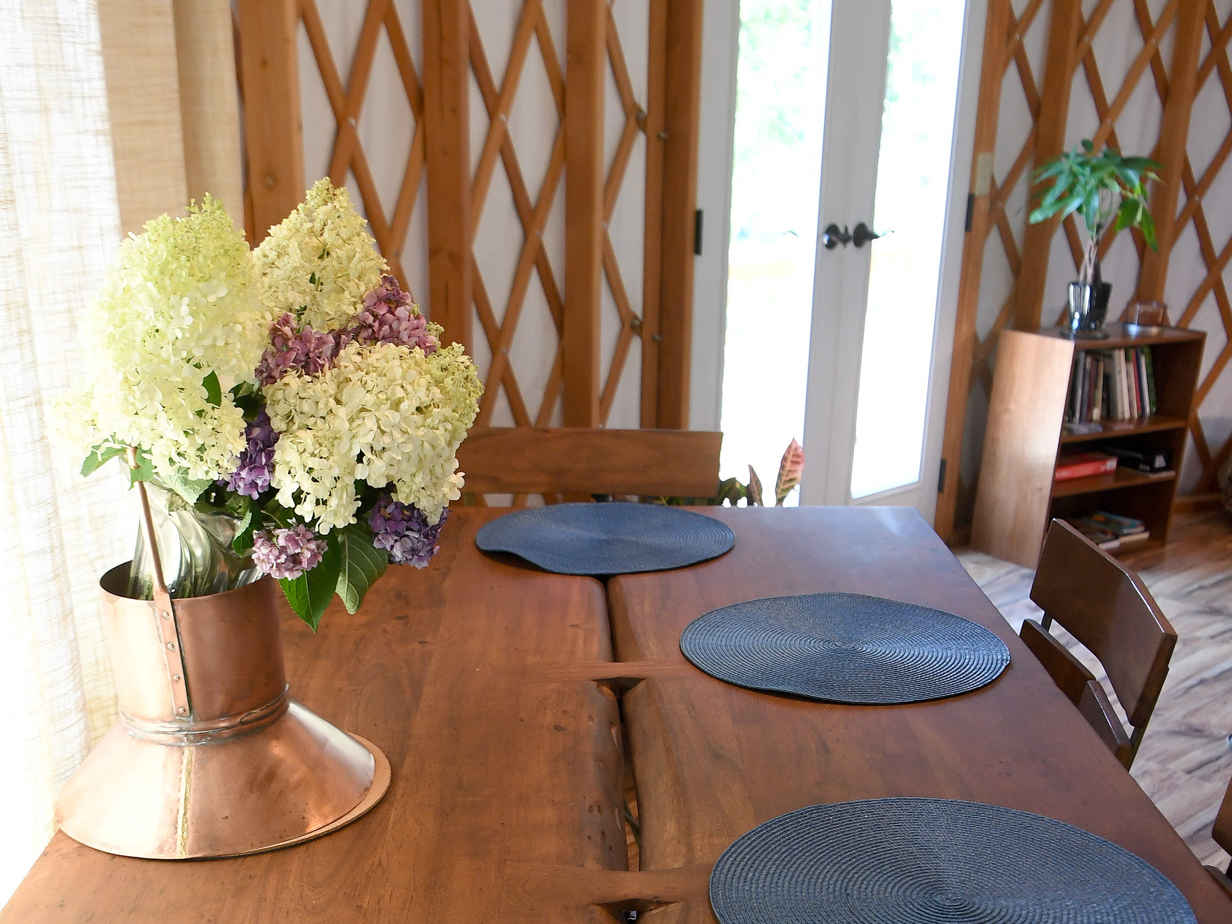 A dining area of the Yin Yurt, an AirBnB rental on Ricardo Fernandez's property in Clyde.