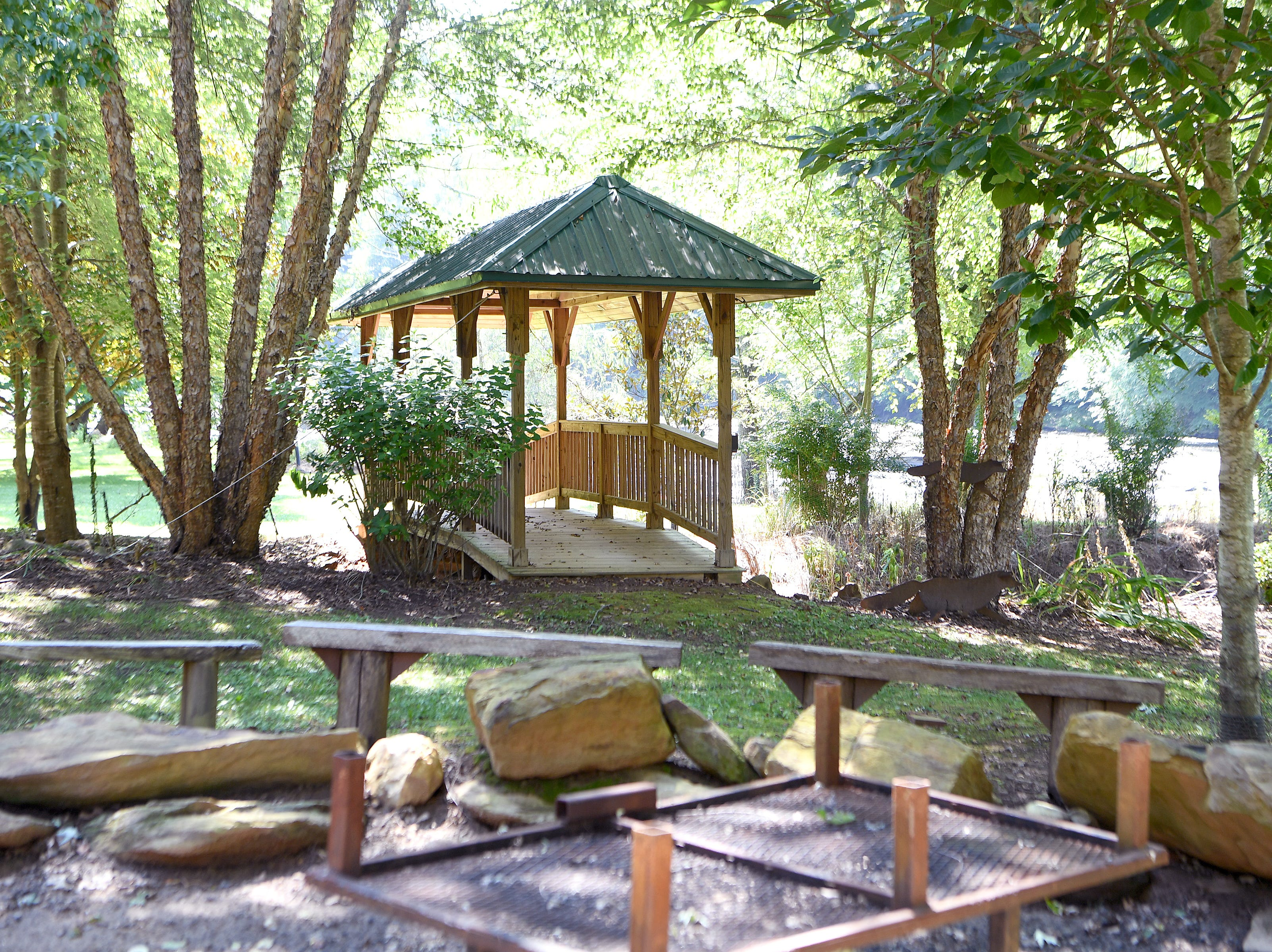 A large fire pit and covered bridge at Ricardo Fernandez's main house in Clyde where the chef teaches culinary experiences, including pizza making and exotic grilling.