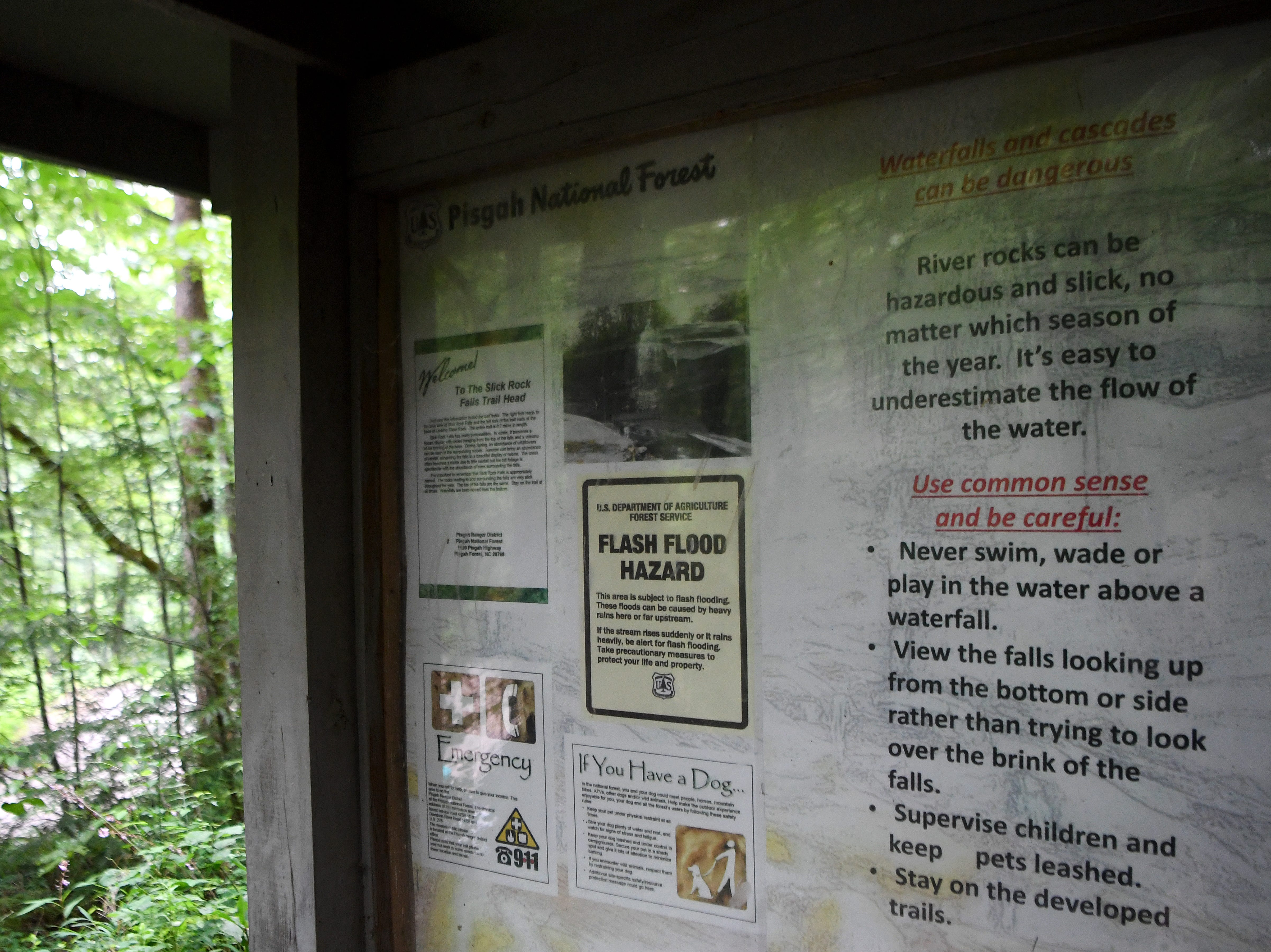 A detailed list of waterfall safety tips greets visitors at the trailhead of Slick Rock Falls in the Pisgah National Forest in Transylvania County.