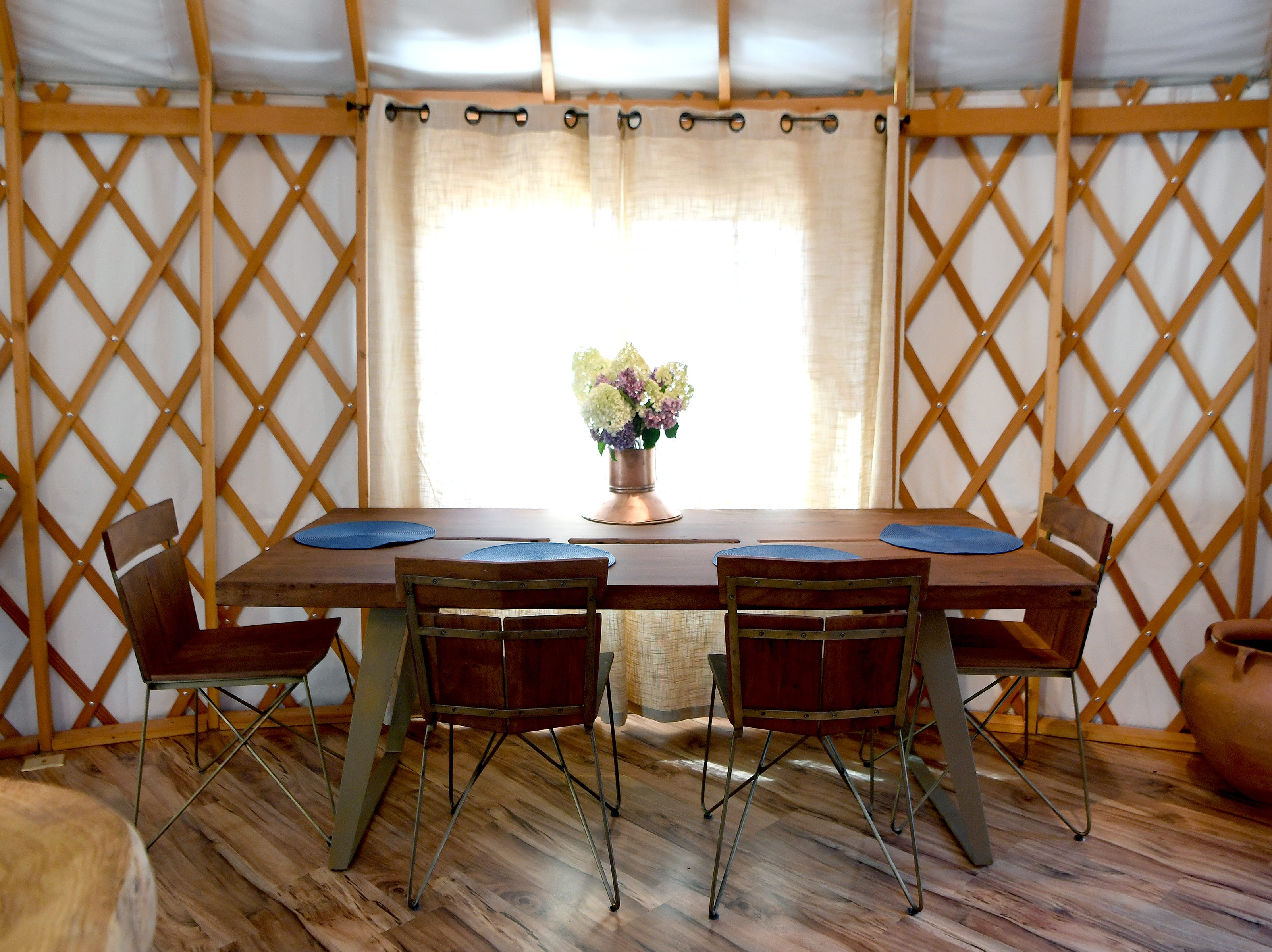 A dining area in the Yin Yurt, an AirBnB rental on Ricardo Fernandez's property in Clyde.