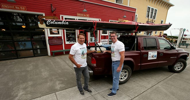 John Kuntz, owner of Olympic Outdoor Center, (left) and his brother Matt Kuntz prepare to head out from Port Gamble to the Columbia River on Wednesday. Kuntz will paddle the river in its entirety, from its source in Canada to the Pacific Ocean.