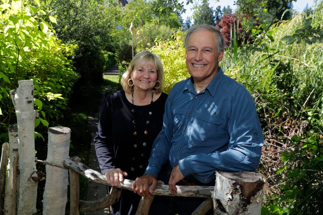 Gov. Jay Inslee and his wife, Trudy Inslee, at their Bainbridge Island home lon July 23. Inslee, a two-term Democratic governor and former congressman, is likely best known outside the state for his focus on climate issues and renewable energy, but lately he's getting noticed for a different role: an adversary to President Donald Trump. And while he's aware of the 2020 presidential chatter that includes his name, Inslee steers conversations on that topic to other elections.