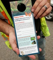 The Washington State Department of Agriculture places informational door hangers if residents are not home and gypsy moth traps are left on their property.