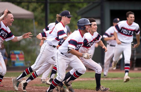 Post 91 players react after their 3-2 walk-off win over the Colchester Cannons to win the 2018 American Legion baseball state championship on Wednesday at Castleton University.