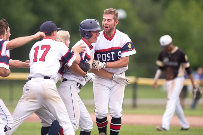 Post 91's Nick Fitzgerald (17) and Maverick King, right, congratulate Cory Giannelli, center, on his walk-off hit to win the American Legion baseball state championship on Wednesday at Castleton University.