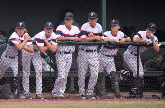 The Post 91 bench watches the action against the Colchester Cannons in the American Legion baseball state championship on Wednesday at Castleton University.