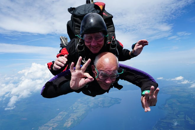 Bruno Trahan of Colchester (without helmet) celebrates his 90th birthday in the skies above West Addison with Ole Thomsen, founder of Vermont Skydiving Adventures on Friday, July 27, 2018.