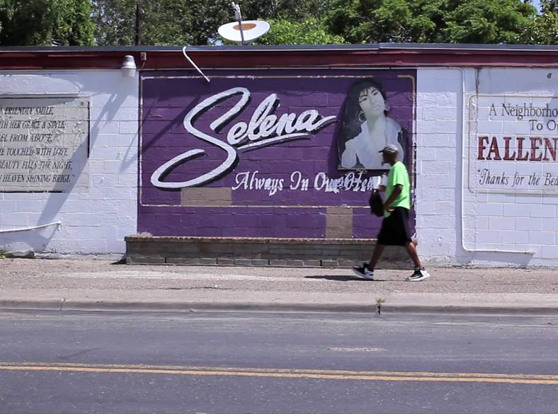 A man walks past the Selena mural on Elvira Drive in the Molina neighborhood.