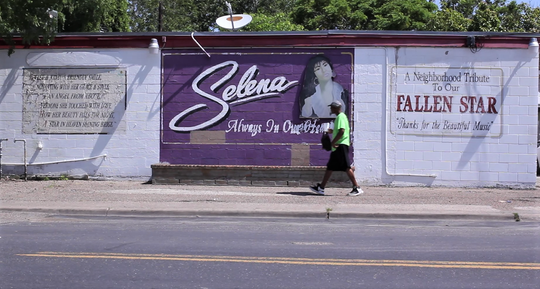 A man walks past the old Selena mural on Elvira Drive in the Molina neighborhood in 2018.